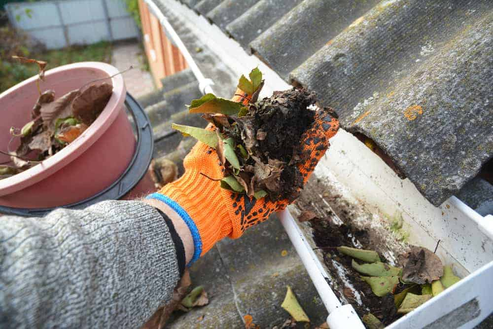 Cleaning leaves, dirt, and other buildup from home gutters